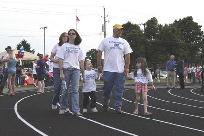 Melissa and D.C. White took their children, Dawson and Natalie, to relay in memory of D.C.'s father.