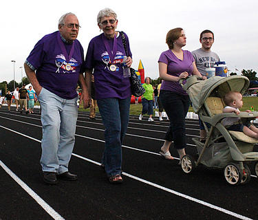 Joel and Martha Ray, Louisville, walk a lap to celebrate their survivor status.