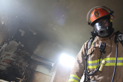 Capt. Jonathan Mattingly walks through the kitchen of a house at 715 N. Third St. The kitchen and other rooms were repeatedly set ablaze for training May 12.