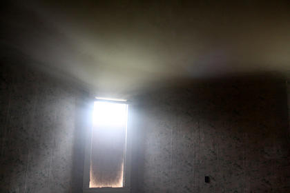 Smoke banks against the ceiling of a room in a house at 715 N. Third St. during a break in training May 12, 2012.