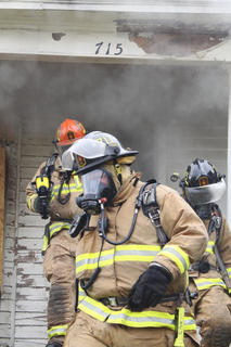 Firefighters exit the house after a training run.
