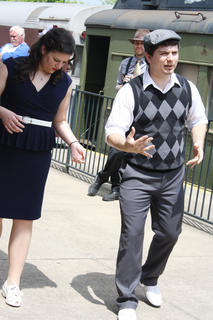 Liz Thatcher, left, and Chris Schoenfelder, of the Louisville Swing Dance Society, teaches the proper footsteps to a swing dance routine.
