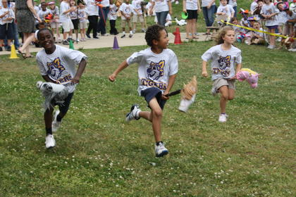 Ja'Markiss Calbert, Jay'Trell Curtsinger and Maddie Livingston run as fast as they can on their horses.