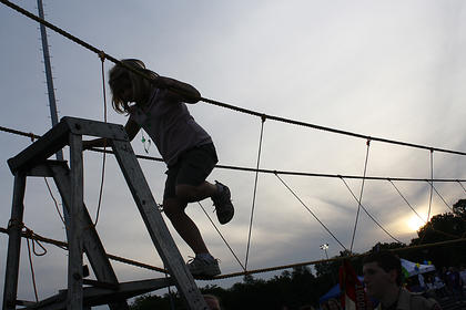 Emily Metcalf, Bardstown, makes one last step in the ropes course set up at Relay for Life Friday night.