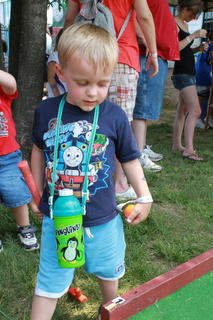 Colton Watts, 2, LaGrange, plays miniature golf in a Thomas the Tank Engine T-shirt during the Thomas & Friends event at the Kentucky Railway Museum in New Haven June 4, 2011.