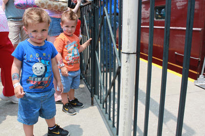 Christopher and Jacob Fryrear, 3-year-old twins from Louisville, wait for the gates to open so they can climb on board Thomas the Tank Engine's train at the Thomas & Friends event and activity day at the Kentucky Railway Museum in New Haven June 4.