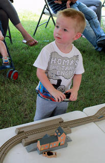 Aiden Morgan, 2, Winchester, plays with toy trains during Thomas the Tank Engine's visit to the Kentucky Railway Museum in New Haven June 4.