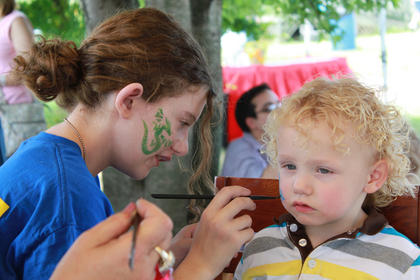 Ayden Glover, 2, Madisonville, gets trains painted on his face to match the day's theme at the Thomas the Tank Engine event and activities day at the Kentucky Railway Museum in New Haven June 4. Face painting was a new activity at the 2011 event.