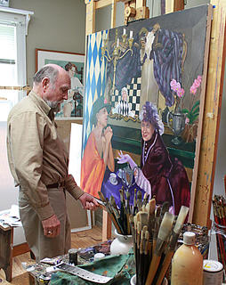 Local artist, Jim Cantrell, places a picture on an easel in his Bardstown studio