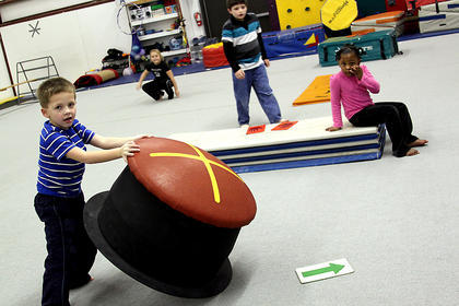 """Students in the Bardstown City Schools enrichment program play at Blue Ribbon Sports Thursday morning. These students are part of a course called """"Fitnastics, Exercise Fun and Game Time,"""" in which they keep active all day long and learn healthy habits."""