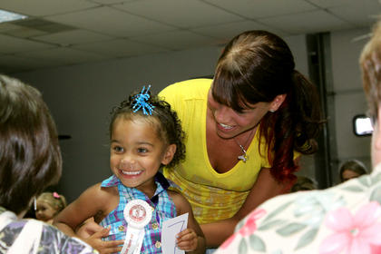 Layla Sheckles smiles at the judges during the Tiny Tots contest at the Nelson County Fair.