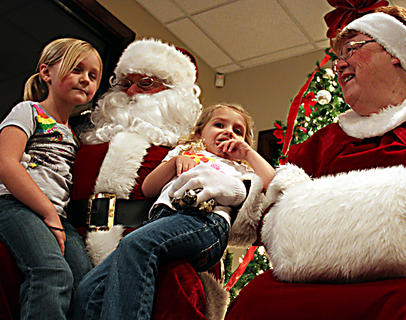 Ella Buchanan, 5, left, and Sydnee Buchanan, 4, visit with Santa and Mrs. Claus at Light Up Bloomfield Nov. 26, 2011. Cookies and goody bags were also on hand.