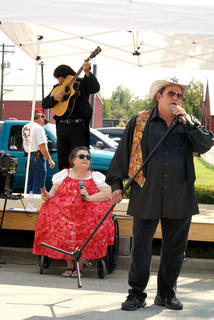 The Perkins Brothers AKA Elvis and Meatloaf performed as Hank Williams Jr. and Johnny Cash along with backup singer Dizzy Queen.