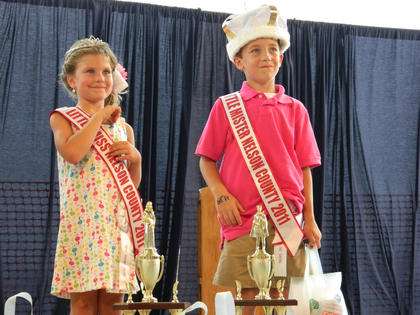 Maddie Livingston, daughter of Chris and LaCasta Livingston, and Jaidyn Sims, son of Brian and Ashley Sims, were crowned Little Miss and Mister Nelson County Fair Tuesday night.
