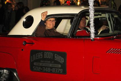 Rita Livers waves to the crowd as her husband, Joe, drives his restored 1957 T-Bird in the parade. The Livers own Livers Body Shop, Inc.