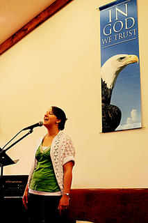 Abby Graves sings a selection during the baptism event at Mill Creek Baptist Church Aug. 7.