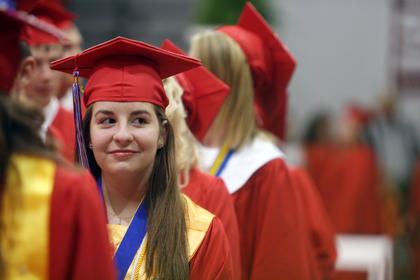 Marthianne Hassell looks out into a crowd of parents and loved ones as she awaits to receive her diploma at Nelson County High School's graduation Friday in the school's gym.