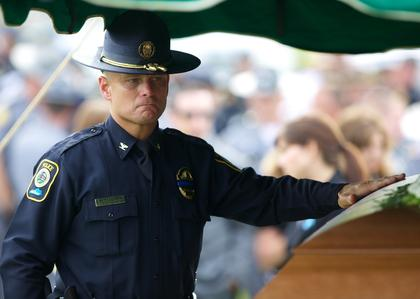 Bardstown Police Chief Rick McCubbin pays his final respects to fallen Bardstown Police Officer Jason Ellis Thursday.