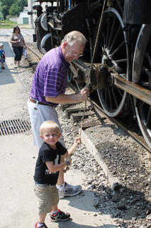 Connor Jones pulls the rope to ring the bell on the old train at the New Haven Railway Museum during a Day Out with Thomas.