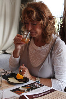 Robbi Ray, Louisville, smells apple cider, one of four flavors guests learned to detect in their bourbon at Any Way She Likes It, a bourbon sampling event geared toward women, hosted by former Master Bourbon Taster Peggy Noe Stevens.