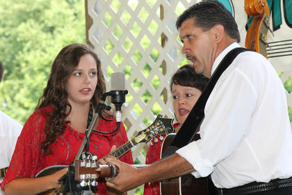 Samantha Patrick; her mother, Debbie Patrick; and father, Rob Patrick, perform with the Daniel Patrick Band. Not shown is Banjo player Brian Lanier. The band performed at the Bardstown Bluegrass Festival at White Acres Campground Saturday.