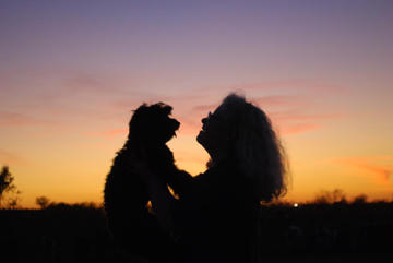 "A photo of Leland Parks' daughter, Emily, having a special moment with her ""puppy,"" Sassy.  Emily received Sassy for Christmas last year and according to her, ""Sassy will always be a puppy!""  They are inseparable!  This photo was taken after the family enjoyed a mile walk at the end of a beautiful October day."