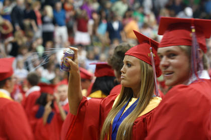 After all the diplomas were handed out, students celebrated by spraying silly string.
