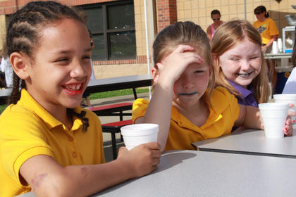 Bardstown Primary School students' mouths were red and blue after eating snowcones at Tigerpawlooza field day June 2, 2011.