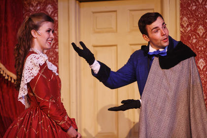 """Stephen Foster (Bronson Norris Murphy) points to his love Jane McDowell (Charlotte Campbell) after Dudley Morton showed up at her doorstep for a date during rehearsal of """"The Stephen Foster Story"""" Wednesday night. The show will run through Aug. 10 with many matinee and night performances."""
