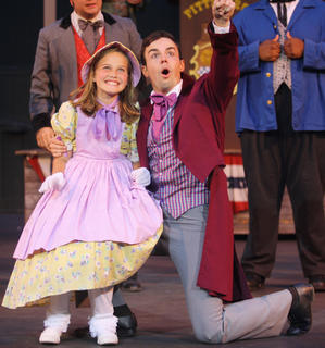 """Stephen Foster (Bronson Norris Murphy) talks to a young girl, portrayed by Laurel Riggs, during a rehearsal of """"The Stephen Foster Story"""" Wednesday night."""