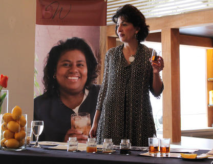 Former Master Bourbon Taster Peggy Noe Stevens directs guests to smell a jar of vanilla — one of the flavors brought out through the charring of bourbon barrels. Stevens hosted Any Way She Likes It, a bourbon sampling event geared toward women, on Friday.