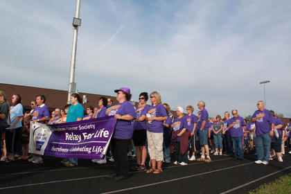 Cancer survivors set off behind the Relay for Life banner for their lap around the Bardstown High School track May 13, 2011, as part of the annual Relay for Life event and fundraiser for the American Cancer Society.
