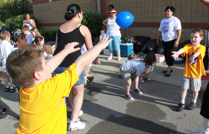 Students try to toss a water balloon without dropping it at the Bardstown Primary School Tigerpawlooza field day June 2, 2011.