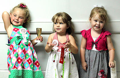 The winners in the Girls 25-36 month category were, from left, first place, Maria Jorja Bartley, daughter of Maria Kasey Bartley, Bardstown; second place, Sophie Elizabeth Sykes, daughter of Nicole Lee Smith and Sean Daniel Sykes, Bardstown; and Alyssa Tucker, daughter of Jason and Regina Tucker, Bardstown.