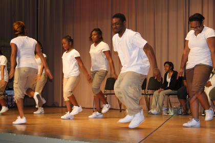 Youth of Greater Friendship Baptist Church, Louisville, give a step performance during the Gospel Explosion.