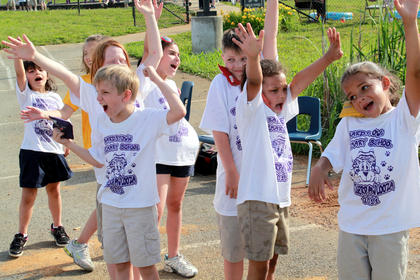 """""""Who's going to have fun?"""" a teacher calls out. """"We are!"""" Bardstown Primary School students answer as they prepare to run a relay with sacks held between their cheek and shoulder at Tigerpawlooza June 2, 2011."""