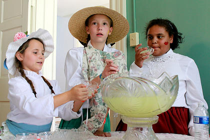 Emma Binkley, 8, left, Cheyenne Kessinger, 11, and Mackenzie Lamar, 9, enjoy lemonade inside the historical home of Wickland at the Wickland 19th-Century Barbecue July 9.