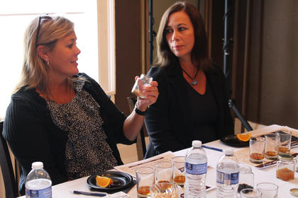 Katrina Egbert, left, and Sheila Schroff, employees of Wild Turkey in Lawrenceburg, smell one of four flavors guests learned to discern in their bourbon at Any Way She Likes It, a bourbon sampling event geared toward women, hosted by former Master Bourbon Taster Peggy Noe Stevens.