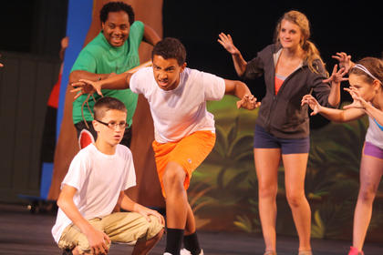 """During rehearsal, actors from """"Shrek — The Musical"""" rehearse a scene detailing the back-story of Shrek."""