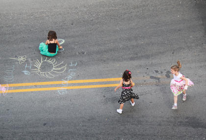 Children draw chalk pictures and dance to the music of Bardstown/Australian folk-rock musician Pauly Zarb's band at Pauly Zarb's 2011 Bardstown Street Concert on North Third Street in Bardstown July 9. Bardstown Main Street Manager Rita Riley estimated the event drew a crowd of 2,500 or more.