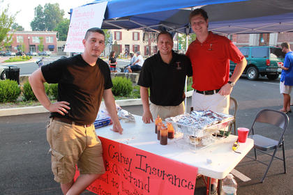 From left, Frank Downs, Patrick Carey and Michael Coen of Parrish and Carey Insurance passed out barbecue and helped sponsor Pauly Zarb's Bardstown Street Concert July 9, 2011.