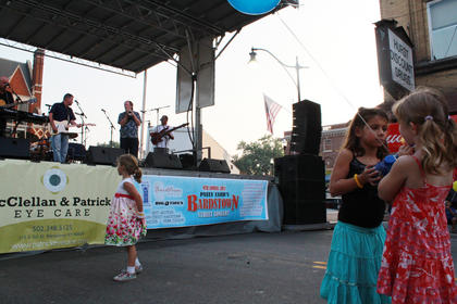 Children dance to the music of Bardstown/Australian folk-rock musician Pauly Zarb's band at Pauly Zarb's 2011 Bardstown Street Concert on North Third Street in Bardstown July 9. Bardstown Main Street Manager Rita Riley estimated the event drew a crowd of 2,500 or more.