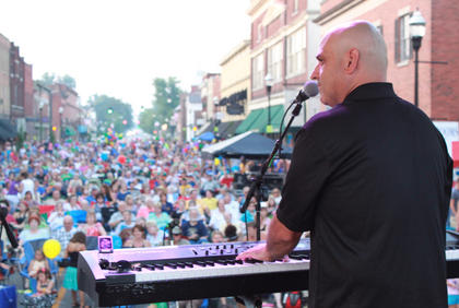 Pauly Zarb performs before a crowd of perhaps 2,500 or more occupying two blocks of North Third Street in Bardstown July 9. Several acts performed at Pauly Zarb's Bardstown Street Concert.