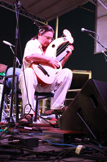 """Fingerpicking champion Edgar Cruz of Oklahoma City performs on a harp guitar at Pauly Zarb's Bardstown Street Concert July 9. Cruz is possibly best known for his YouTube rendition of Queen's """"Bohemian Rhapsody."""""""
