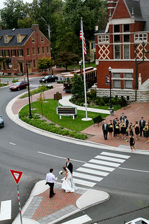 A couple took photos with their wedding party in front of the Old Courthouse in Bardstown the afternoon of Oct. 1.