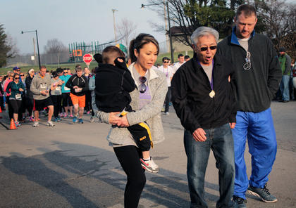 With the help of family, 77-year-old Robert Kwee takes the first few steps of the third annual Forget Me Not Fun Run. Kwee was diagnosed with Alzheimer's at the age of 66.