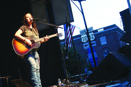 Ashley McBryde performs in front of a crowd during the Bourbon City Street Concert Saturday on North Third Street.