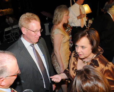 Bethlehem principal Tom Hamilton and Cathy Clements chat during cocktail hour at Lights, Camera, Auction! at Bethlehem High School Saturday.