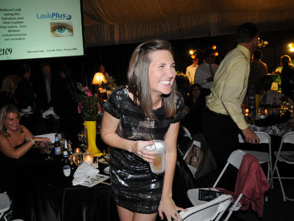 Millicent Ballard laughs after losing in a bidding war at Lights, Camera, Auction! in the gymnasium of Bethlehem Saturday.