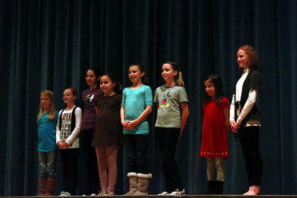 """A group of """"Oz"""" hopefuls stand close together for a picture after finishing their audition."""
